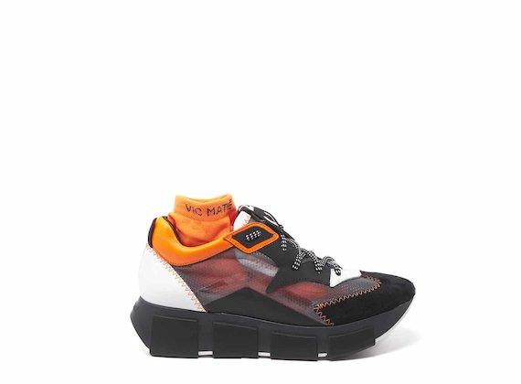 Chaussures de course avec empeigne transparente noir et orange