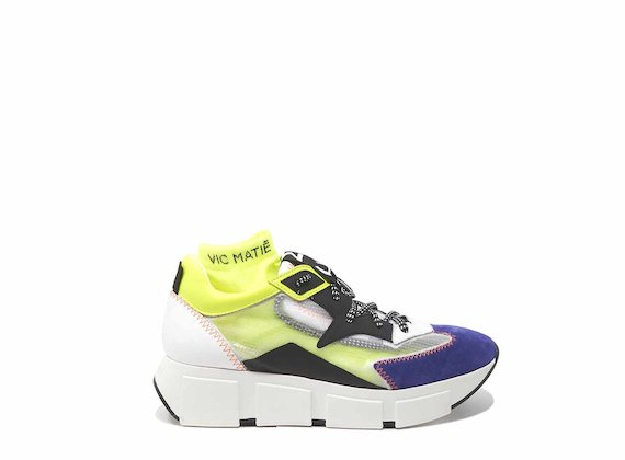 Purple/yellow running shoes with see-through upper