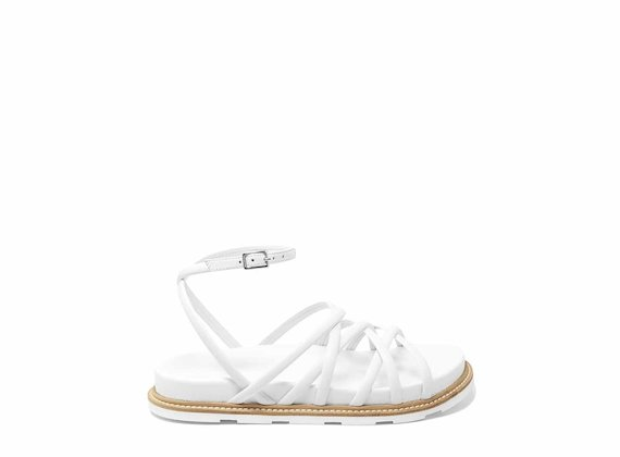 White sandals with criss-crossing strips