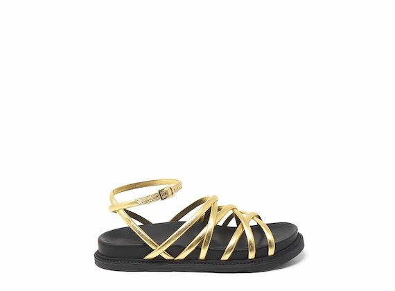 Golden sandals with criss-crossing strips