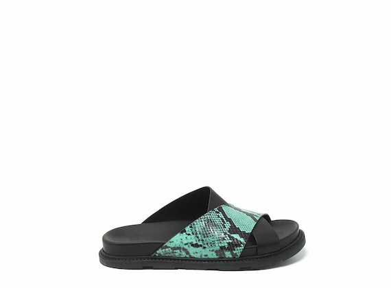 Black/turquoise criss-crossing slip-ons