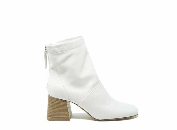 White ankle boots with flared heels