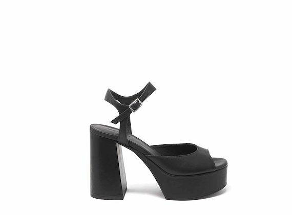 Raised black leather sandals