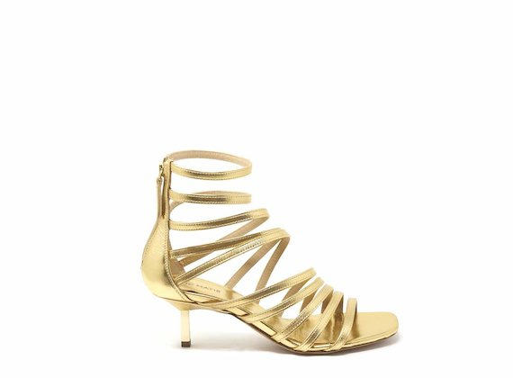 Golden gladiator sandals with kitten heel