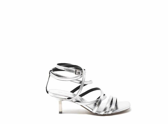 Silver sandals with kitten heel and ankle straps