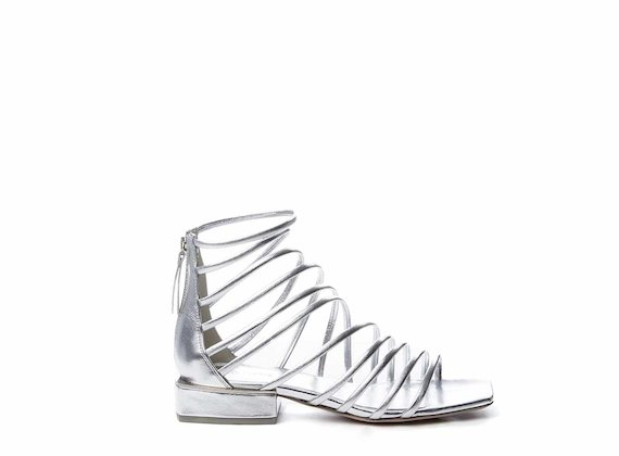 Silver sandals with criss-cross strips