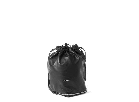 Harper<br>Sac paquetable en cuir violet/noir.