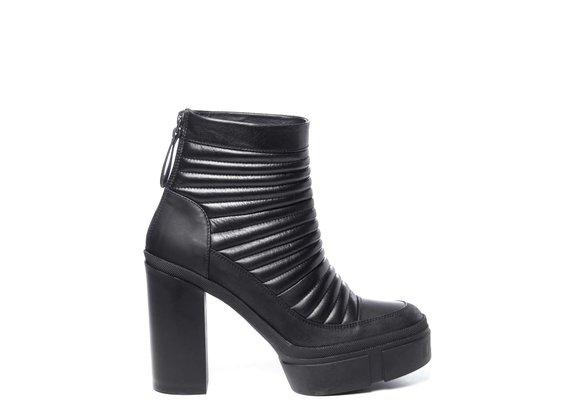 Black biker-style calfskin ankle boots with platform
