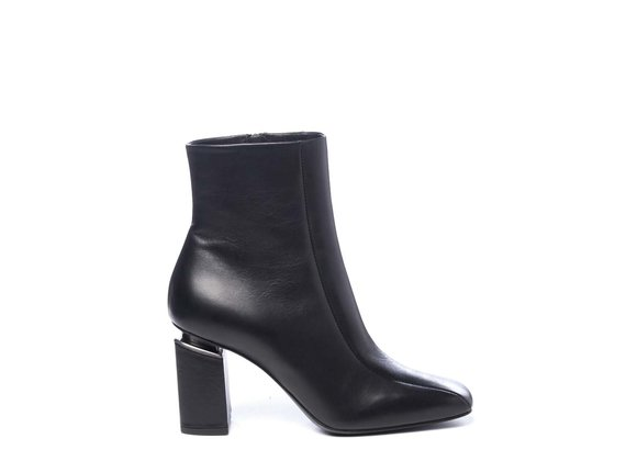 Black calfskin ankle boots with suspended heels