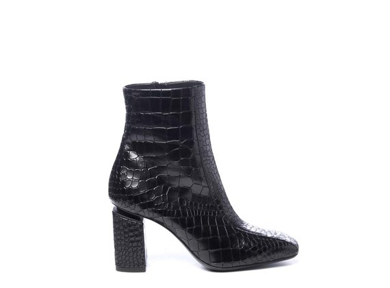 Black crocodile-print leather ankle boots with suspended heels