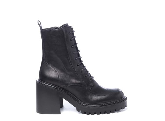 Lugged-sole combat boots in black calfskin