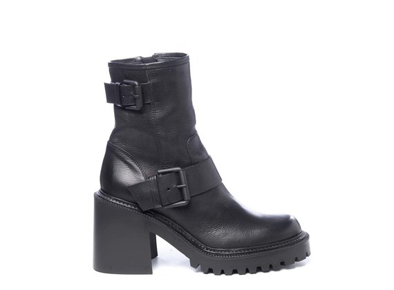 Black biker-style ankle boots in calfskin with lugged soles