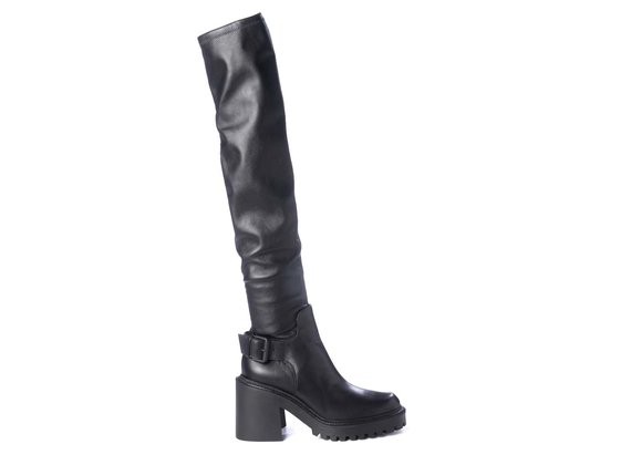 Black over-the-knee boots with lugged soles