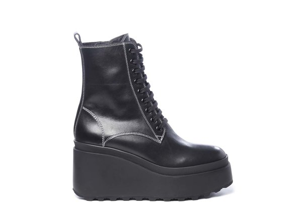 Black calfskin combat boots with wedge