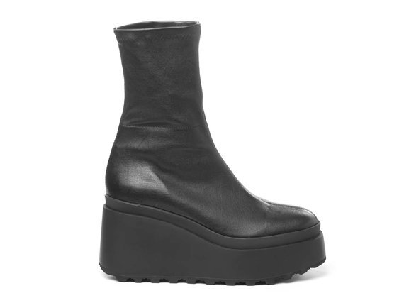 Black ankle boots in soft stretch leather with wedge