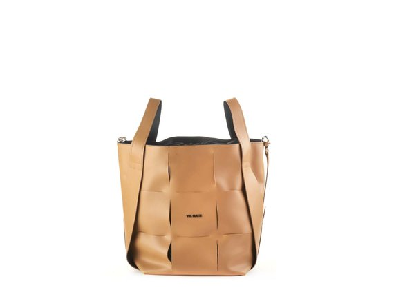 Nadege<br />Large tan-brown leather bucket bag
