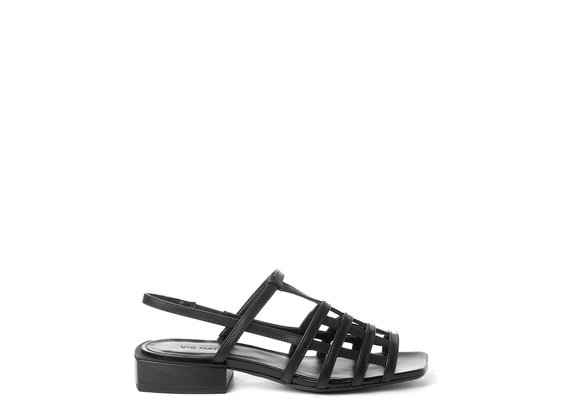 Flat cage sandals in black calfskin