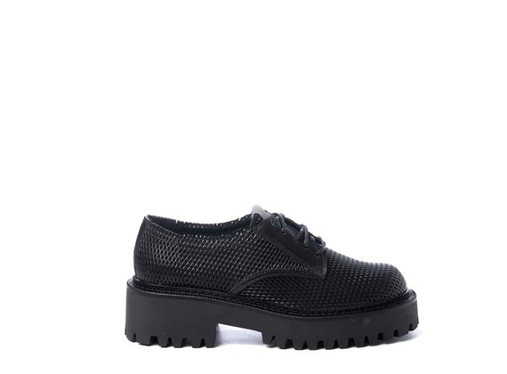 Black lace-ups in perforated calfskin