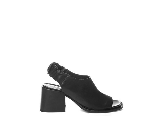 Black calfskin sabots with open toe