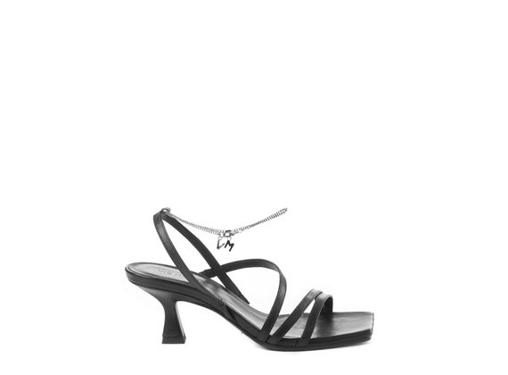 Black sandals with spool heel and strips