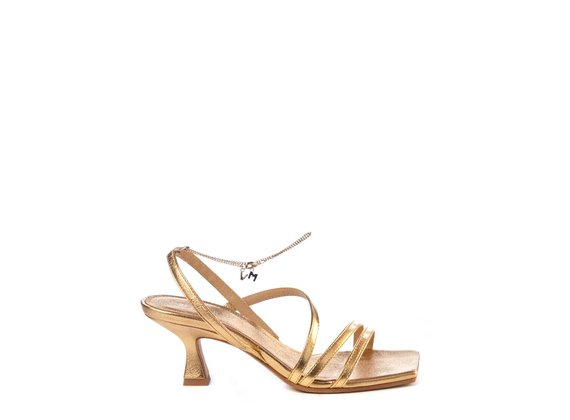 Golden sandals with spool heel and strips