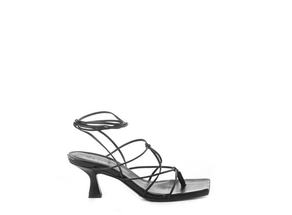 Black sandals with leather strings and spool heel