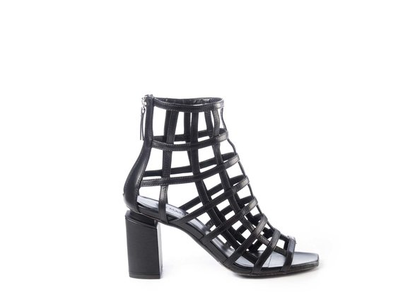 Black cage-effect ankle boots with suspended heel