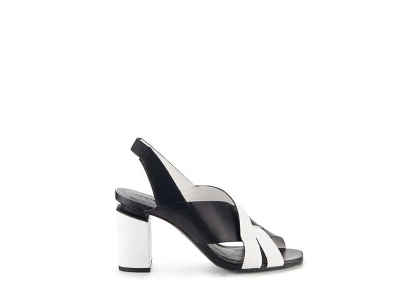 Black and white chanel sandals with suspended heel