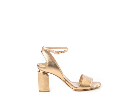 Golden sandals with suspended heel
